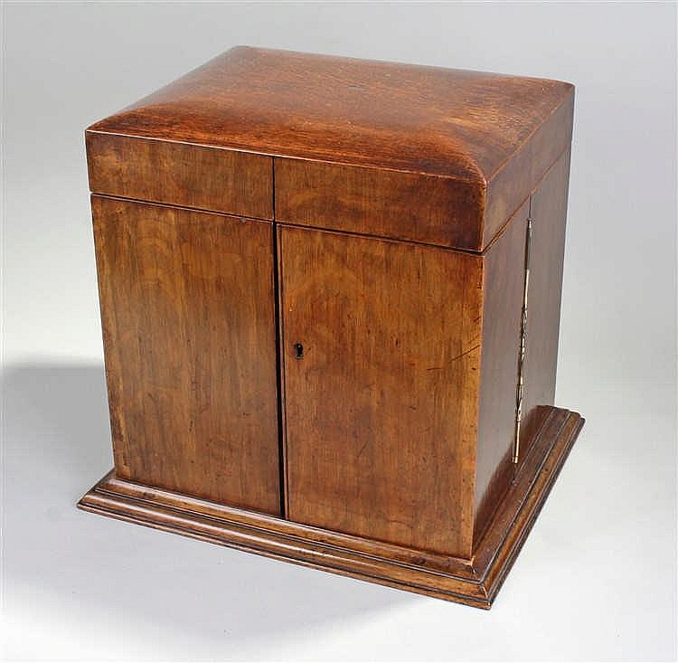 Victorian oak tantalus, the hinged top opening to reveal a mirror back, thr