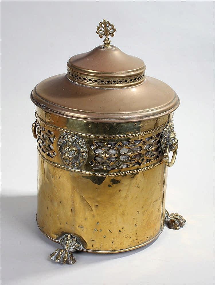 Brass circular lidded coal box raised on hairy paw feet with lion mask hand