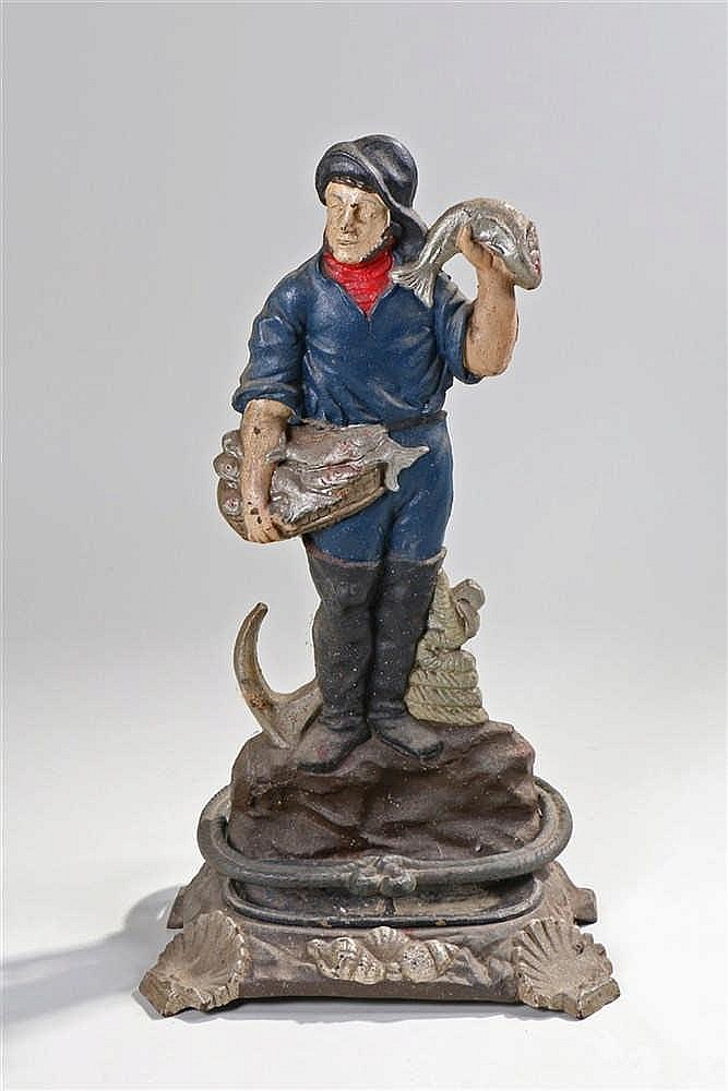 Figural cast iron stick stand, in the form of a fisherman and his catch, th