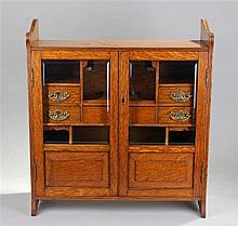 Early 20th Century oak smokers cabinet, the rectangular top with a pair of