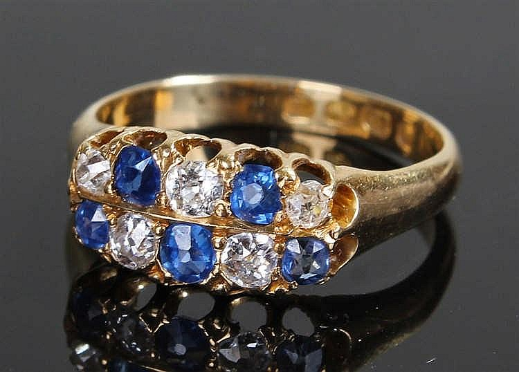 18 carat gold, sapphire and diamond ring, with twin rows of round cut sapph