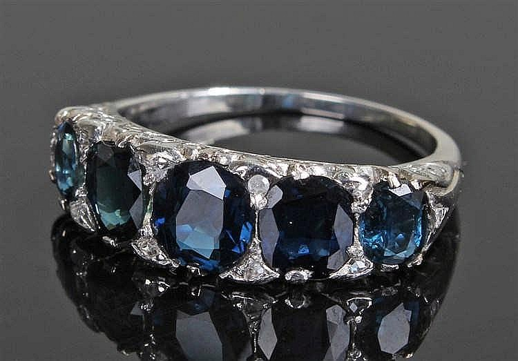 Sapphire and diamond ring, the row of five sapphires at approximately 2.50
