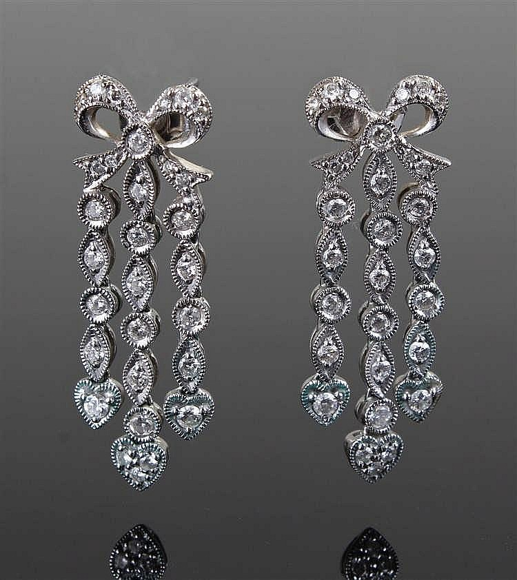 Pair of diamond drop earrings, the top of each earring formed as a bow with