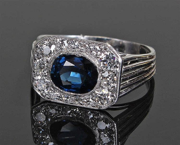 Sapphire and diamond ring, the central sapphire flanked by diamonds to the