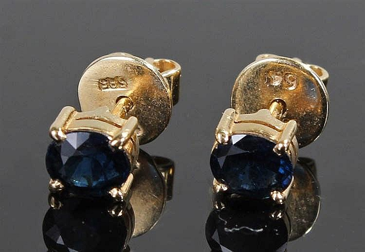 14 carat gold sapphire set earrings, with an oval sapphire to each, total c