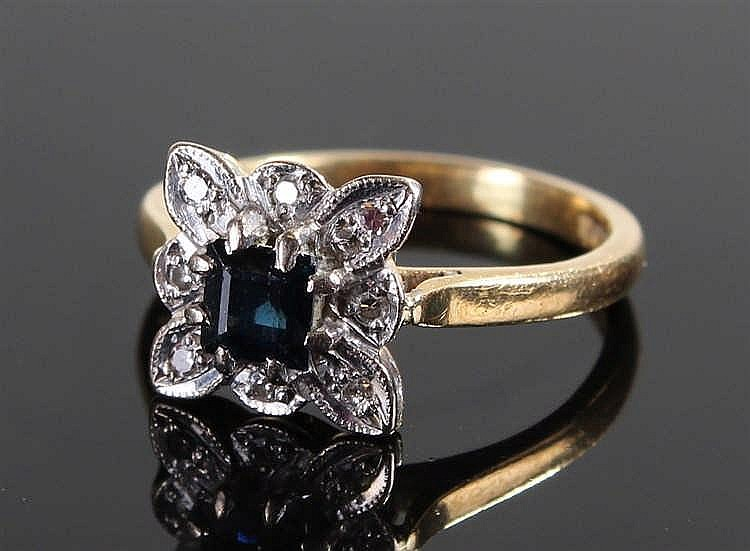 18 carat gold sapphire and diamond ring, the sapphire set in a flower head