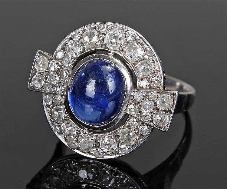 Art Deco sapphire and diamond ring, the central cabochon sapphire set withi