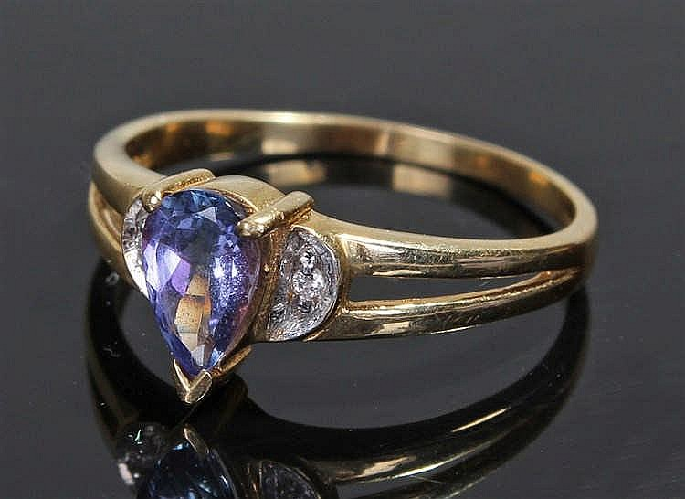 18 carat gold amethyst set ring, the pear cut amethyst with diamonds to the