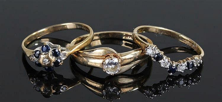 Three 9 carat gold rings, two with sapphires and cubic zirconia, the other