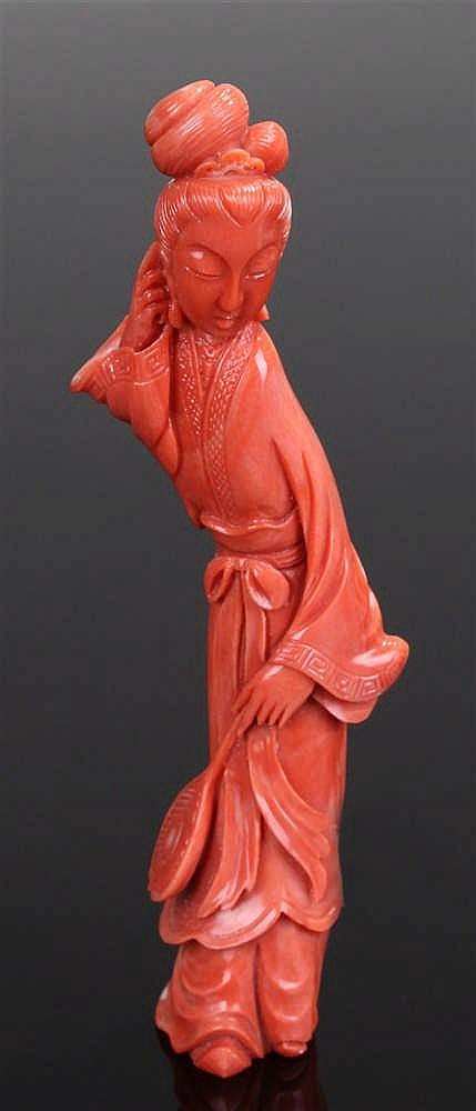 Fine and large Chinese coral figure, of a lady holding a lotus leaf with lo