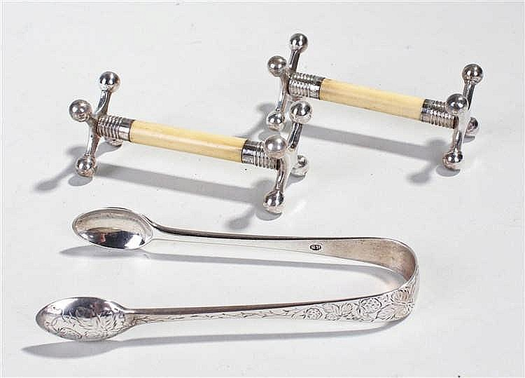 Edward VII silver sugar tongs, London 1902, together with a pair of ivory a