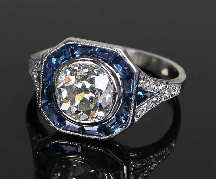 Diamond and sapphire ring, the central diamond at 1.80 carats surrounded by