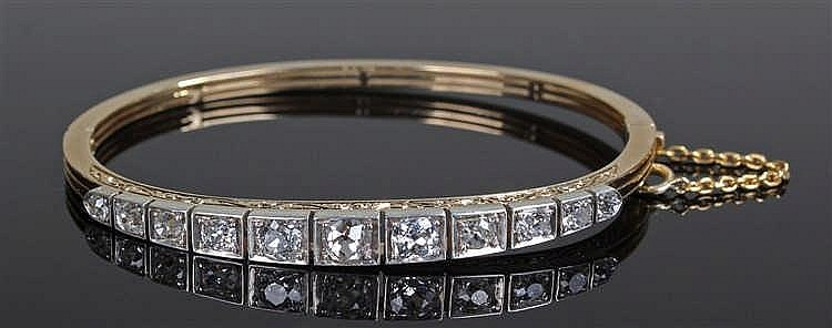 Diamond set bracelet, set with eleven round cut diamonds, 6.4cm wide