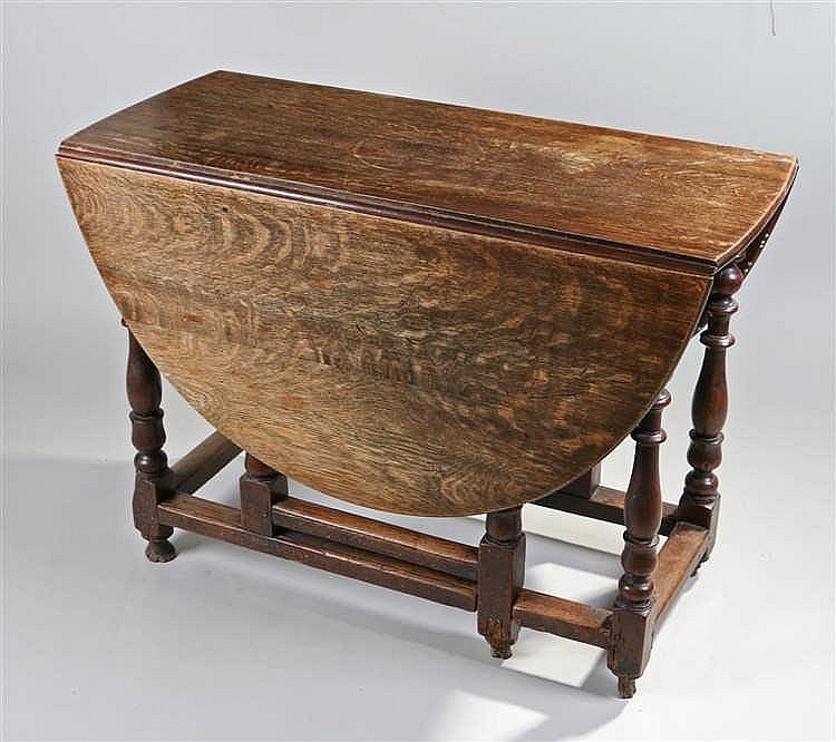 18th Century oak gateleg table, the drop flap top above turned legs united