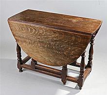 18th Century oak gateleg table, the drop flap top above turned legs united