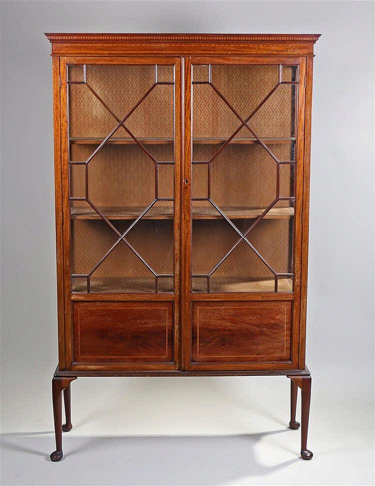 Early 20th Century mahogany and inlaid display cabinet the concave cornice