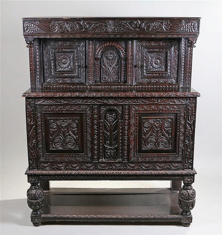 17th Century and later court cupboard, the top section with carved acanthus