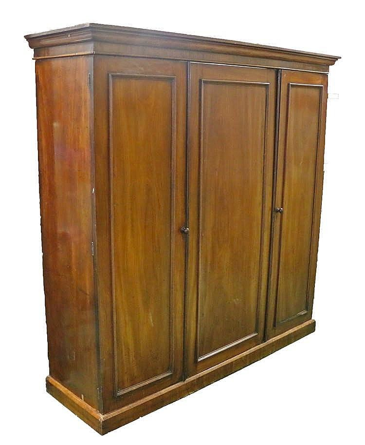 Victorian mahogany triple wardrobe, the central cupboard door enclosing a s