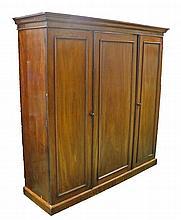 Victorian mahogany triple wardrobe, the central cupboard door enclosing a s