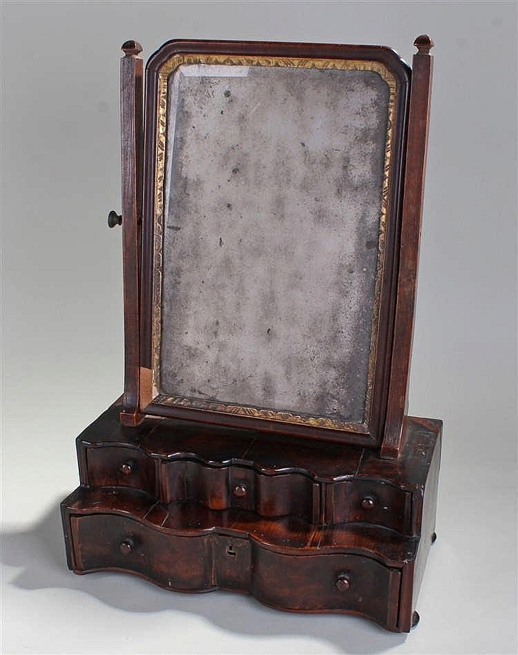 George I mahogany toilet mirror, the mirror plate with gilt gesso edge held
