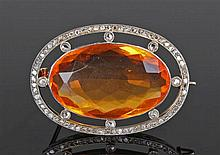 Fire opal and diamond brooch, the fire opal at 17.25 carats surrounded by d
