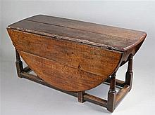 18th Century oak drop leaf table, of large proportions, the drop leaf round