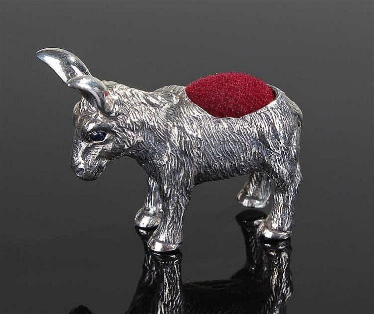A silver pin cushion in the form of a donkey