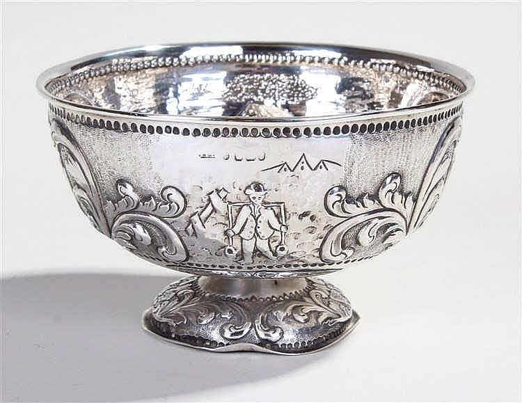 19th Century Dutch silver bowl, decorated with a man carrying milk pales.