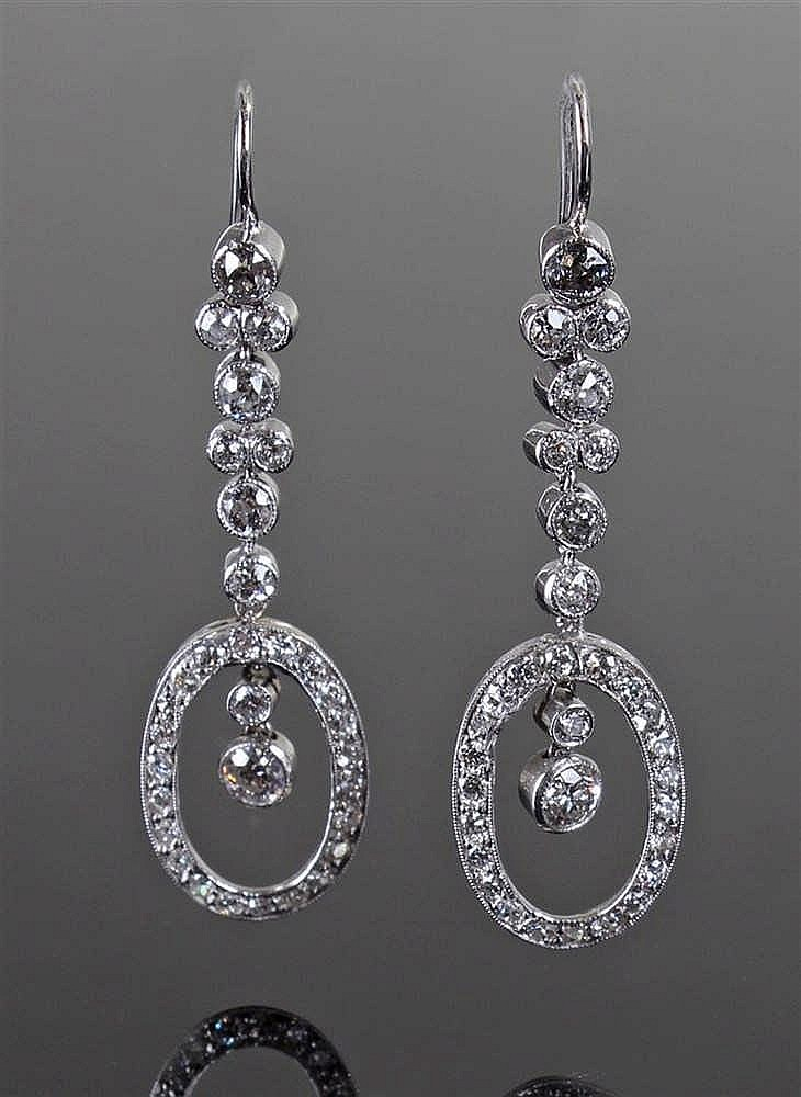 Pair of diamond set drop earrings, the diamond set band with an oval end en