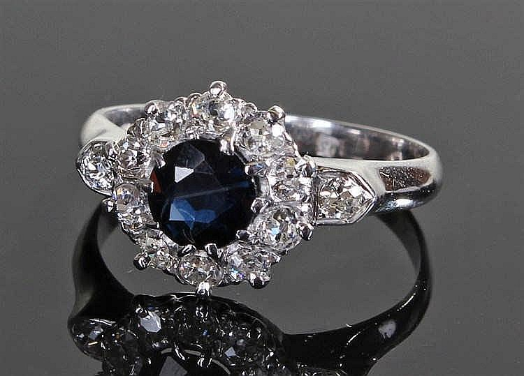 18 carat white gold sapphire and diamond ring, the central sapphire with el