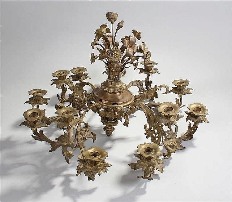 Continental cast brass chandelier, the twelve arms in the form of flowering