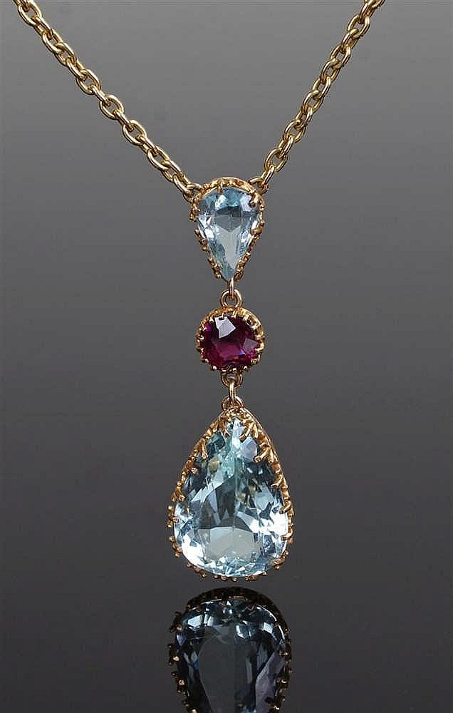 Aquamarine necklace, the 15 carat gold chain attached to an aquamarine drop