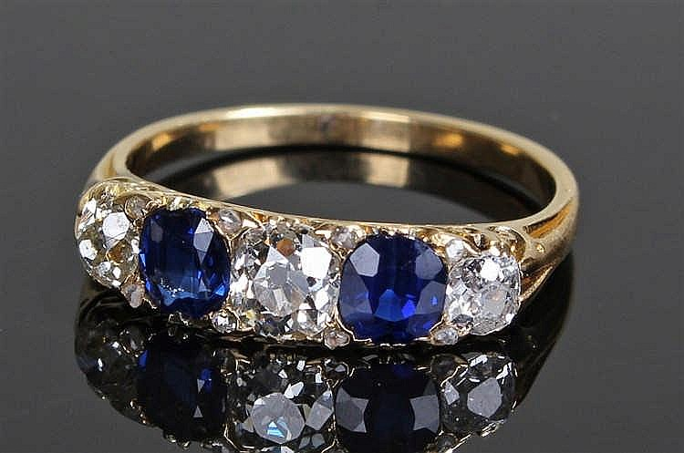 Sapphire and diamond ring, the pair of sapphires at a total of 0.68 carats