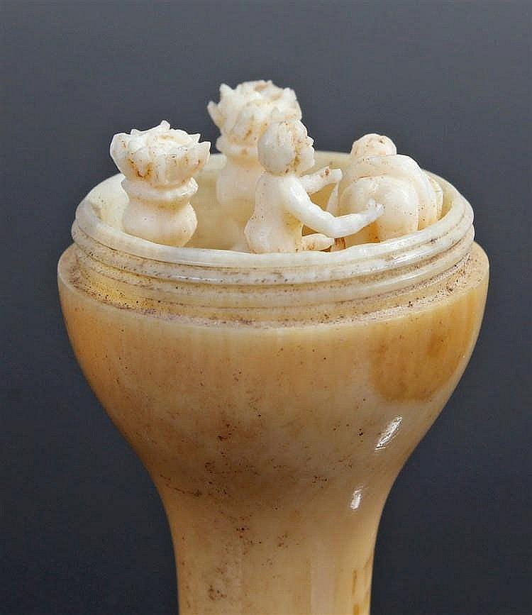 19th Century ivory erotic group, the vase shaped, screw vessel enclosing an