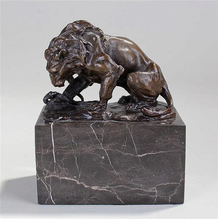 Louis Carvin bronze, of a lion above a snake, signed L Carvin, raised upon