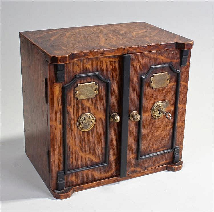 Victorian novelty oak tea caddy, in the form of a safe, the rectangular top