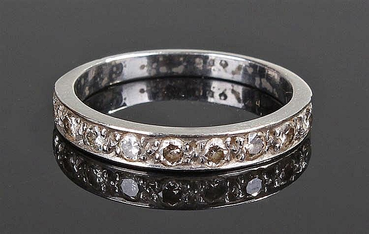Platinum and diamond half eternity ring, the row of diamonds to the taperin