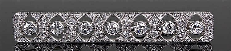 Diamond set brooch, the brooch with a row of seven round cut diamonds surro
