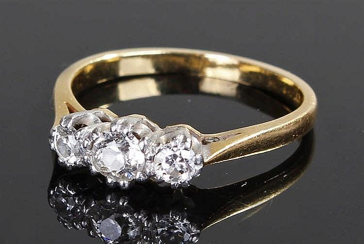 18 carat gold diamond ring, the ring set with three diamonds to the platinu