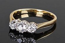 18 carat gold diamond ring, the ring set with three diamonds to the platinu