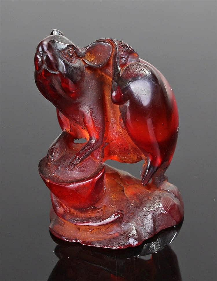 Japanese amber Rat, carved as a rat scratching his ear, 50mm high