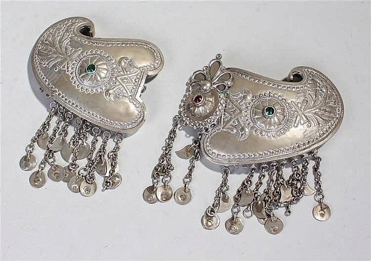 Middle Eastern white metal buckle, of large proportions, the shaped buckle