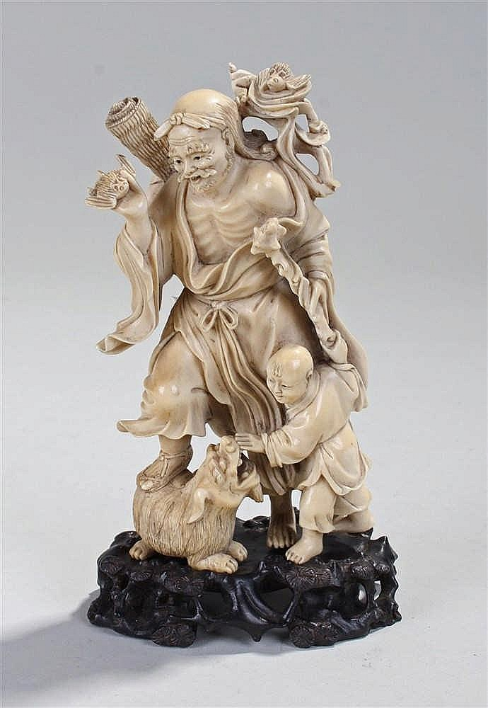 19th Century Japanese okimono, the carved figure with bats to his hand and