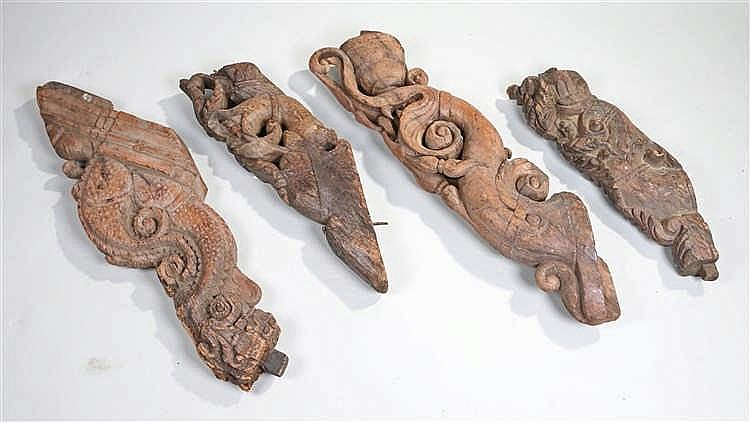 Four 18th Century Indian carved corbel brackets, the four pieces carved wit