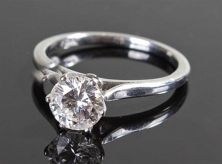 Fine platinum and diamond set solitaire ring, the round cut diamond at appr