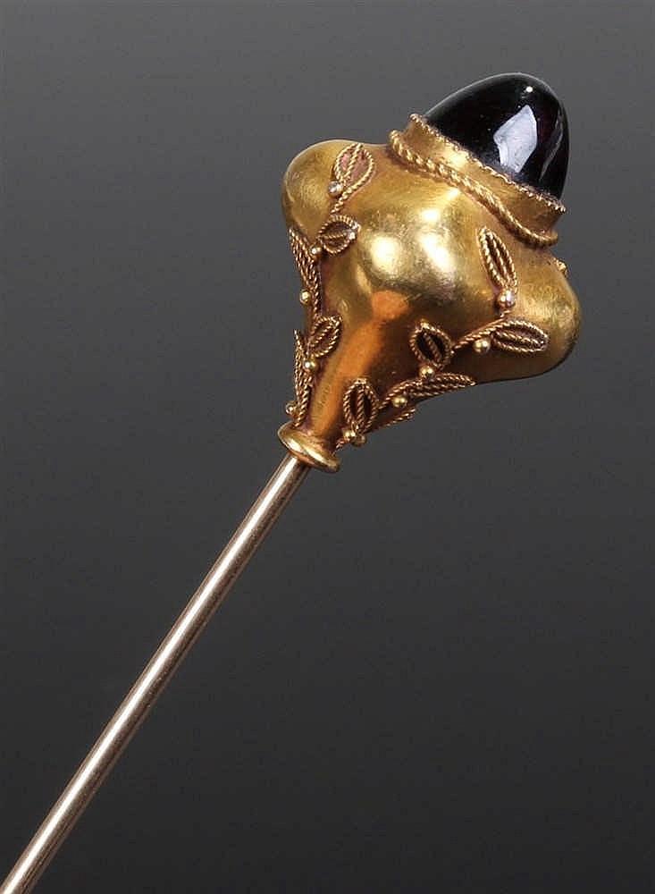 Etruscan style garnet stick pin, the sugar loaf cabochon garnet set within