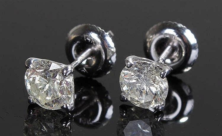 Pair of white gold and diamond ear studs, each stud at 0.75 carat round cut
