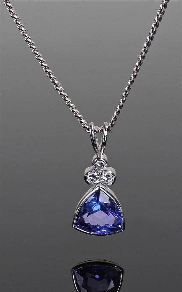 18 carat white gold diamond and tanzanite necklace pendant, the arching tri