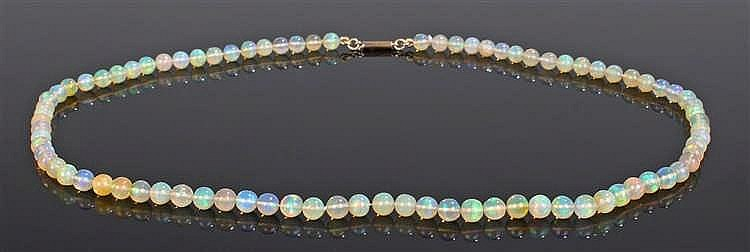 Opal necklace, with a row of opal spheres and a gold clasp end, 48cm long
