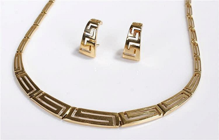 14 carat gold necklace and earring set, designed with elongated zig zags, t